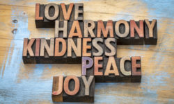 love, harmony, kindness, peace and joy - inspirational word abstract in vintage letterpress wood type